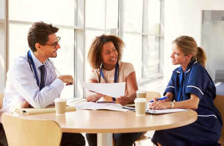 Three people having a meeting